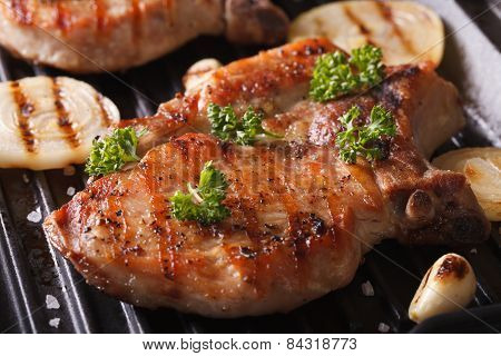 Juicy Pork Steak Grilled With Onions In A Pan Grill Closeup