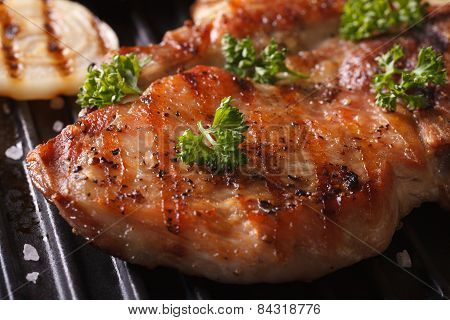 Juicy Pork Steak Grilled With Onions In A Pan Grill Macro