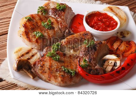 Roast Pork With Grilled Vegetables On White Plate Horizontal