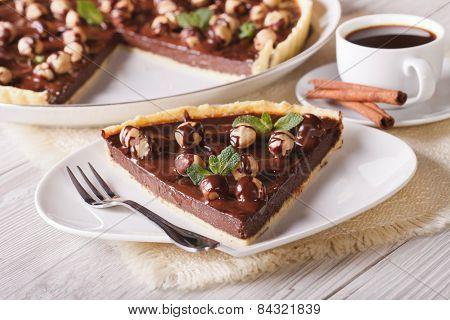 Chocolate Tart With Hazelnut And Coffee Close-up. Horizontal