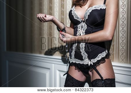 Sexy Woman In Corset Locking Handcuffs