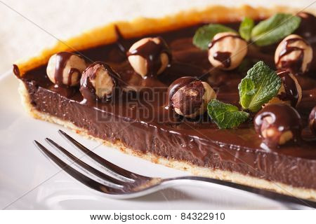 Chocolate Tart With Hazelnut And Mint On Plate Macro.