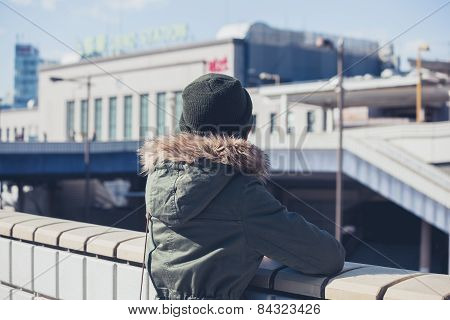 Woman Looking At Station In Winter