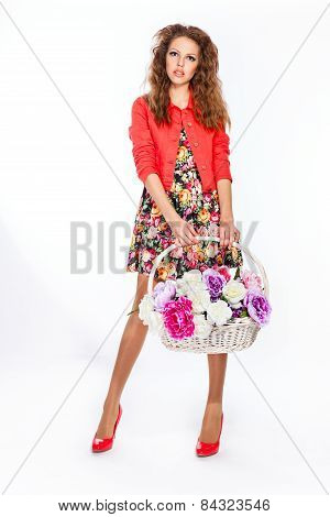 Teenage Girl Holding A Basket Of Flowers