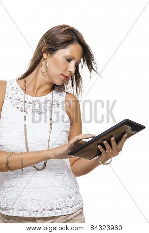 Woman Chatting On A Mobile While Reading A Tablet