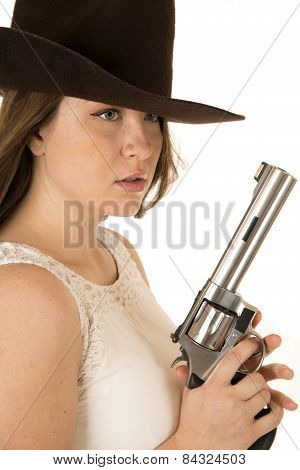 Tough Cowgirl Holding Large Pistion Looking Far Away