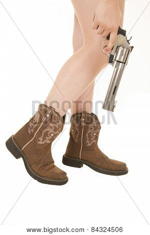 Woman's Legs Boots And Revolver In Her Hands White Background