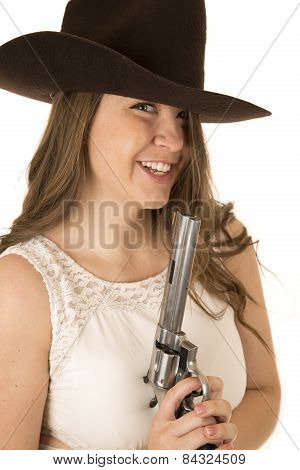Cute Cowgirl Holding A Big Pistol Looking Forward Laughing