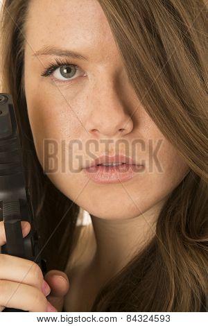 Brunette Female Model Pointing A Gun Very Close Up Portrait
