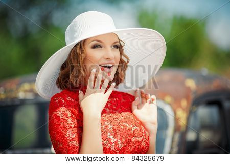 Beautiful woman in white hat expresses the joyful emotions