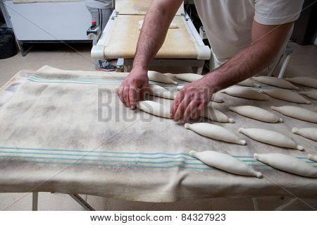 Kneading And Placing Pieces Of Bread Over Fermentation Table