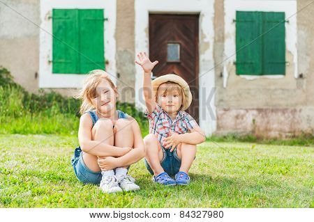 Adorable children resting in a countryside