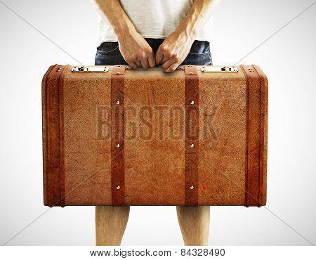 Man Holding Leather Suitcase
