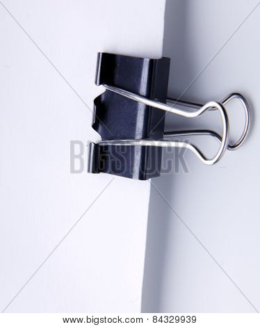 Blank paper with clip isolated in white background