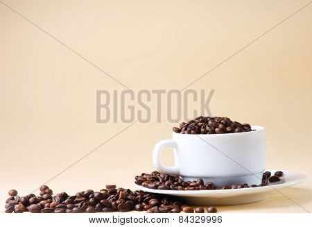 Cup from coffee on  grains