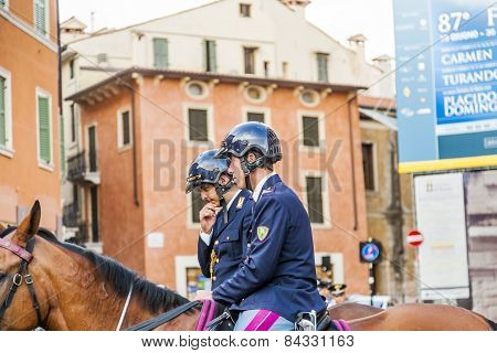 Police On Horses Are Watching And Helping The Spectators At The Arena Di Verona
