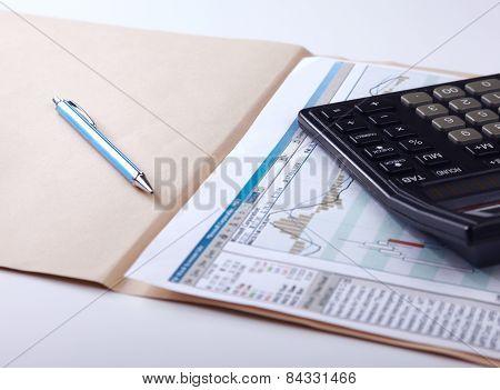Calculator, pen, folder with documents