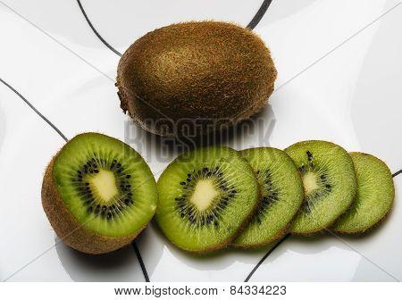 Sliced And Whole Kiwi Fruit