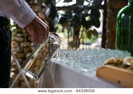Man Pours A Water