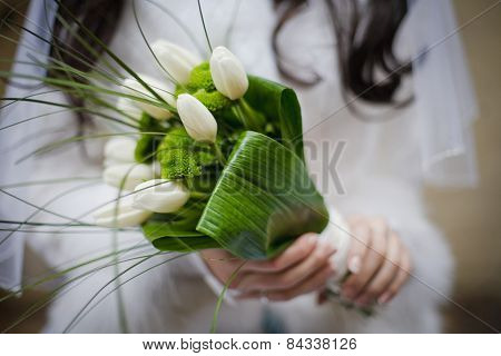 Bride Holding Wedding Bouquet From White Tulipes And Golden-daisies