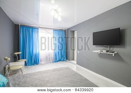 Interior of bedroom. Modern minimalist style bedroom interior in grey tones