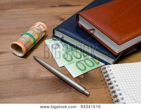Money, notepad and pen