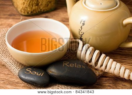 Tea Set On Wooden Board And Lava Stones
