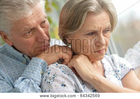 Sad elder couple