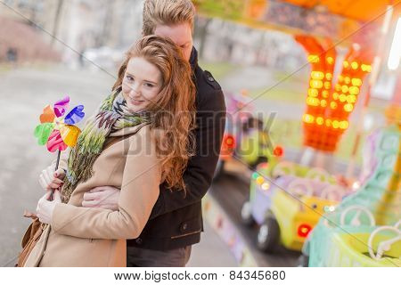 Young Couple In The Amusement Park