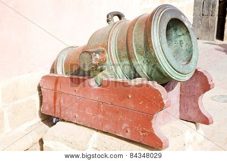 In Africa Morocco  Green Bronze Cannon And The Blue Sky