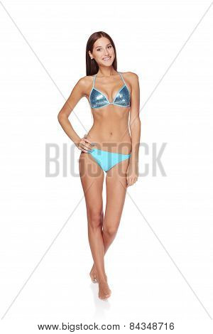 Slim tanned woman in blue bikini