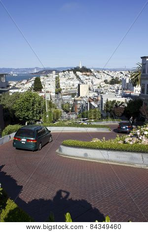 Car crossing the famous Lombard Street in San Francisco