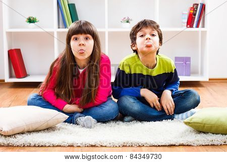Children sticking out tongue