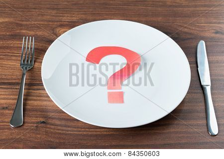 Plate With A Question Mark On Desk
