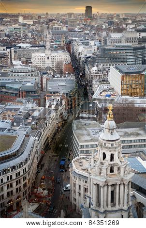 Busy streets of City of London in the dusk. First evening lights and