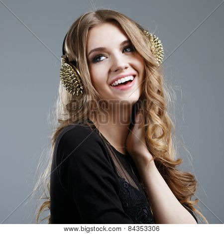 Beautiful Smiling Woman Listening To Music