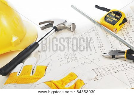 Yellow Hardhat On Drawings