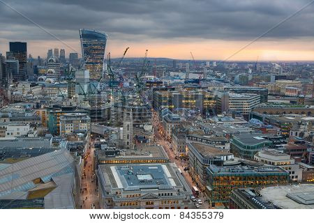 London in sunset. First evening lights on streets. London's panorama from the St. Paul cathedral
