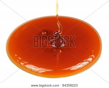 Dripping Honey On White Background