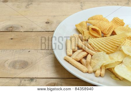 Mix Snacks In Dish On Wood Background