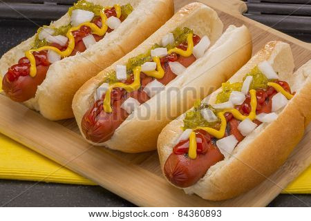 Hot Dogs on a Wood Cutting Board
