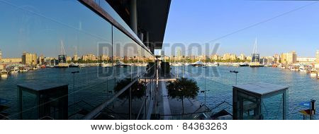 Barcelona port with teleferico reflected in window