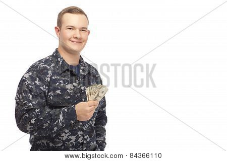Young Man In Navy Uniform With Money