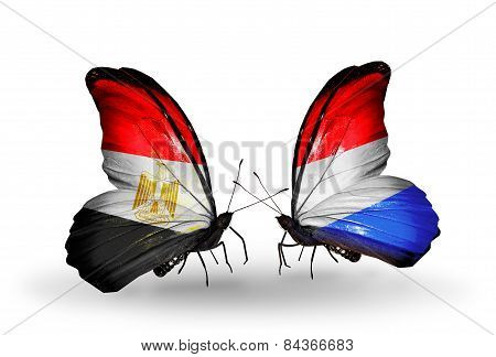 Two Butterflies With Flags On Wings As Symbol Of Relations Egypt And Luxembourg