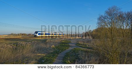 Train moving through the countryside in winter