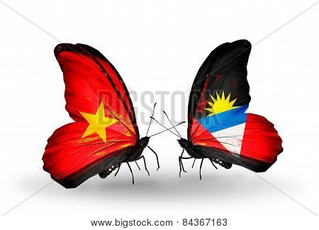 Two Butterflies With Flags On Wings As Symbol Of Relations Vietnam And Antigua And Barbuda