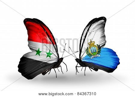 Two Butterflies With Flags On Wings As Symbol Of Relations Syria And San Marino