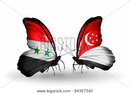 Two Butterflies With Flags On Wings As Symbol Of Relations Syria And Singapore