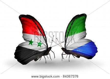 Two Butterflies With Flags On Wings As Symbol Of Relations Syria And Sierra Leone