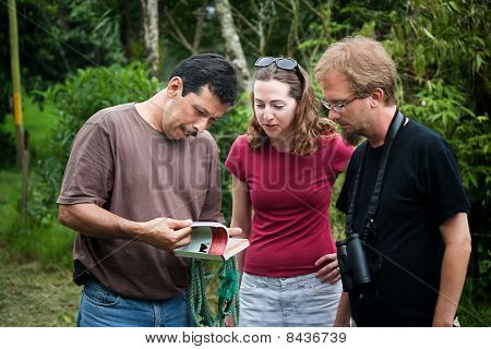European Or American Tourist With Nature Guide In Costa Rica
